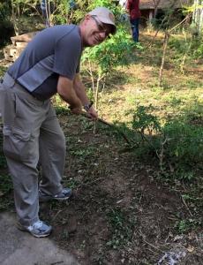 Father Jeff working on the iguana farm