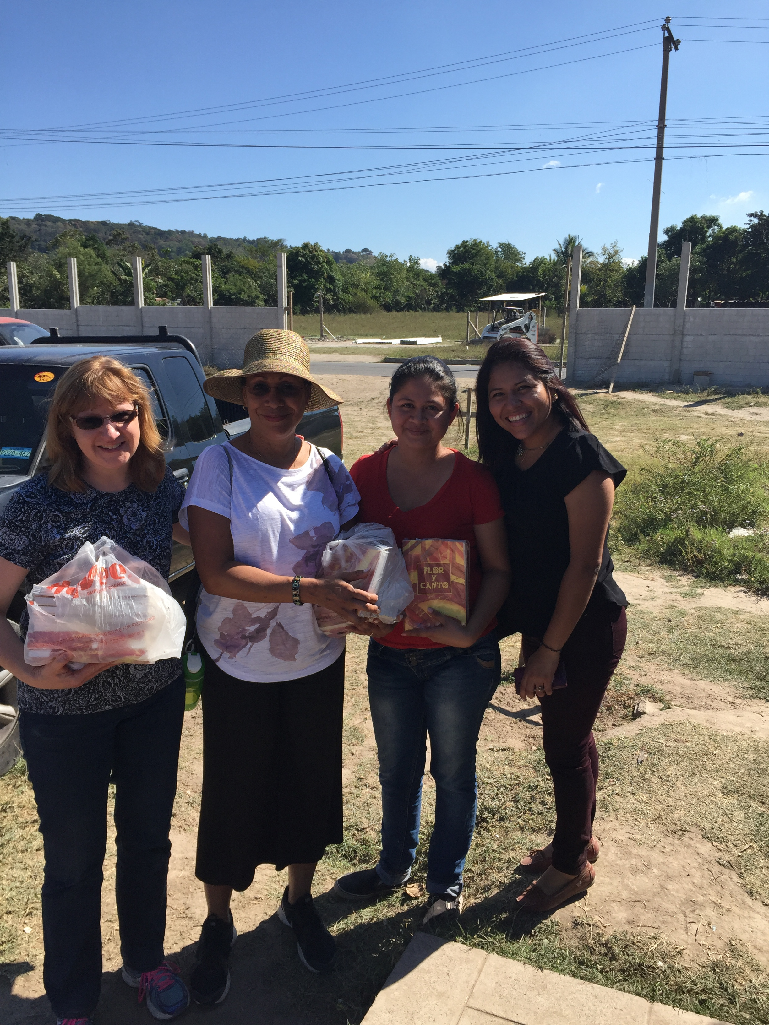 Delivering hymnals to the Romero Community
