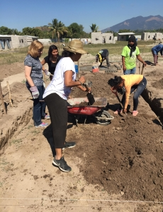 Kris and Jeannine help build new homes in one of the communities they visited in El Salvador